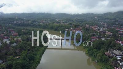 Old Bridge Crossing Nam Khan River At Luang Prabang, Drone Footage