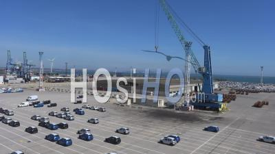 Parking Cars At The Container Terminal Of The Port - Video Drone Footage