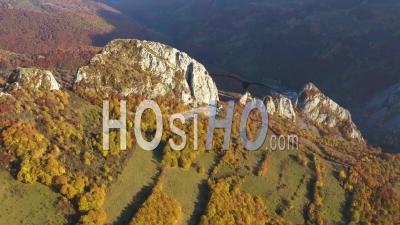 Flying Over Autumn Forest And Limestone Cliffs - Video Drone Footage