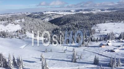 Flying Over Winter Landscape With Snowy Fir Trees And Mountains - Drone Point Of View