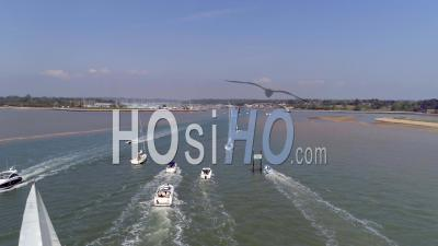 Boats And Yachts Out On A Sunny Day Enjoying The Weekend Exploring The Waters Either By Motor Or Sail, Uk - Drone Point Of View