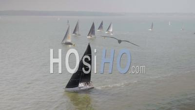 Crews Compete In The Fast 40 Sailing Races On The Solent In The Uk. The 40 Foot Racing Yachts Use The Skill Of The Crew To Race Throughout The Day. - Drone Point Of View