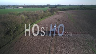 Farm Machinery Spraying Glyphosate Herbicide On Farm Crop. - Drone Point Of View