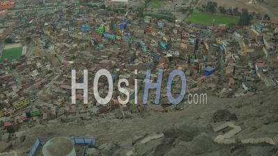 Lima Peru Flying Down San Cristobal Hill Over Barrios Panning Up. - Video Drone Footage