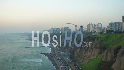 Lima Peru Flying Over Coastline Beach Panning With Cliff Site Parks And City Views. - Video Drone Footage
