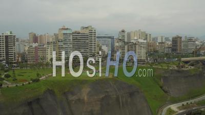 Lima Peru Flying Backwards Away From Cliff Side Parks And Paragliding Launch Area. - Video Drone Footage