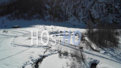Musher In Alpine Landscape - Video Drone Footage