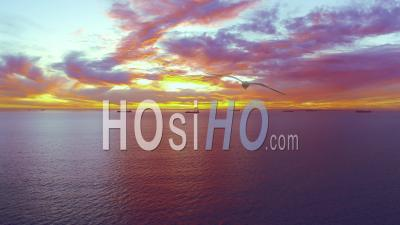 Rise High Above Ocean To Reveal Spectacular Sunset - Drone Point Of View