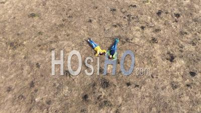Drone Point Of View Of Girls Laying In A Meadow