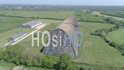 Aerial View Of An Airship Hangar In Ecausseville, Normandy, France - Video Drone Footage