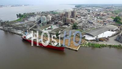 Cement Red Boat Around Douala Bridge - Video Drone Footage