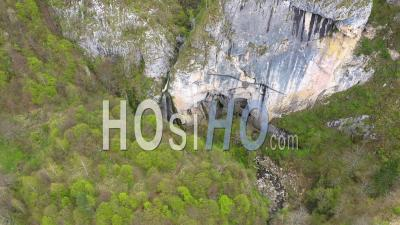 Video Drone Footage Of A Big Cave Entrance And Waterfall In The Mountains