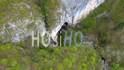 Drone View Of A Waterfall And Big Cave Entrance