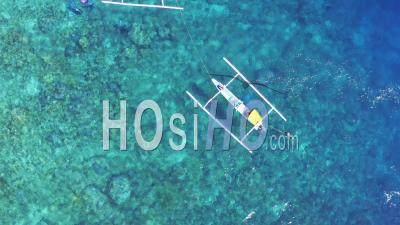 Fishing Boats, Divers In Striking Blue Water - Video Drone Footage