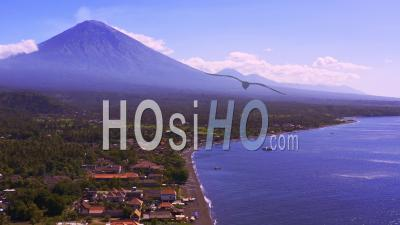 Amed Revealing Angry Mount Agung And Mount Batur - Video Drone Footage