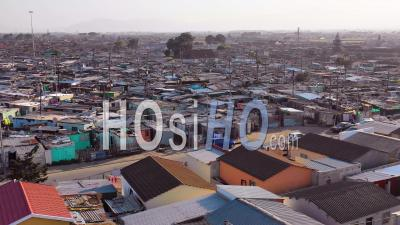 Aerial View Over Gugulethu, One Of The Poverty Stricken Slums, Ghetto, Or Townships Of South Africa - Drone Point Of View