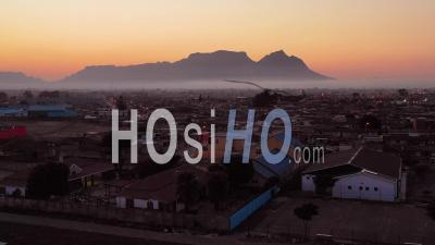 Aerial View Over Township In South Africa, Vast Poverty And Ramshackle Huts, At Night Or Dusk - Video Drone Footage