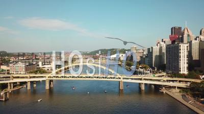 Aerial View Over Bridges On The Monongahela River To Pittsburgh, Pennsylvania Downtown Skyline - Video Drone Footage