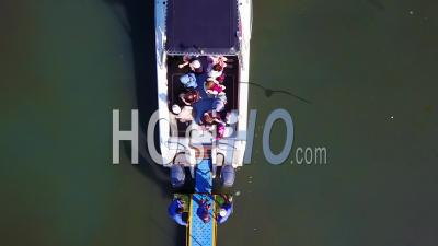 Aerial View Over A Small Dive Tour Boat Filled With Tourists Off The Coast Of Namibia - Video Drone Footage