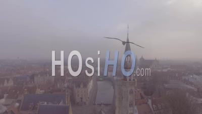 Aerial View Of A Mysterious Foggy Day In Bruges, Belgium With Cathedral Churches And Spires In Distance - Video Drone Footage