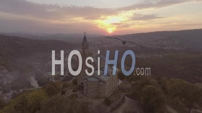 Aerial View Of A Majestic Ancient Stone Cathedral Or Church In Bulgaria At Sunset - Video Drone Footage