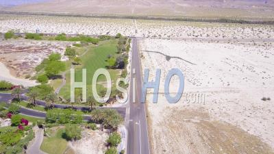 Aerial View Of Greenery And Desert Near Palm Springs California - Video Drone Footage