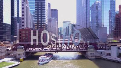 Aerial View Over An El Train Crossing The Chicago River In Downtown Chicago - Video Drone Footage