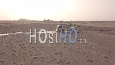 Aerial View Over A 4x4 Jeep Traveling Across The Deserts Of Djibouti Or Somalia - Video Drone Footage
