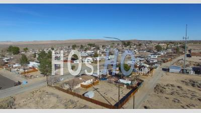 Aerial View Over A Lonely Desert Community In The Mojave Desert Of California - Video Drone Footage