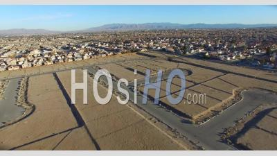 Aerial View Over Desert Reveals Housing Tracts And Empty Lots In The Desert - Video Drone Footage