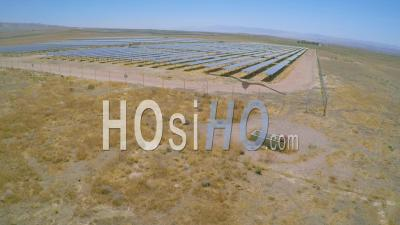 Aerial View Over A Vast Solar Array Farm In The California Desert, United States Of America - Video Drone Footage