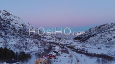 Sunset In A Snowy Valley With Mountains In The Backgrounds - Video Drone Footage