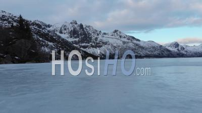 Over A Frozen Lake In The Lofoten Islands - Video Drone Footage