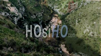 A Small River At The Bottom Of A Canyon In Cavagrande (sicily) - Video Drone Footage