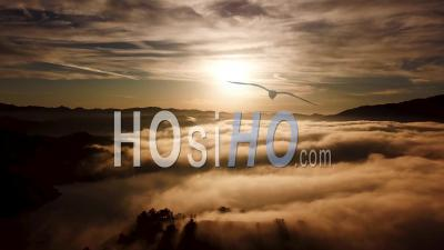 Aerial View Over Fog On A Golden Beautiful Souithern California Sunrise In The Region Of Ojai California - Video Drone Footage