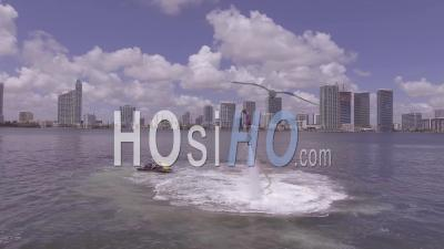 A Man Hovers Using A Water Jetpack Flyboard On The Ocean In Miami, Florida - Drone Point Of View