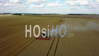 Combine-Harvester In A Wheat Field - Video Drone Footage