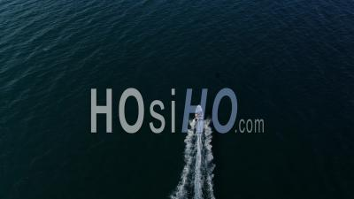 Powerboat Navigating On A Blue Calm Sea - Video Drone Footage