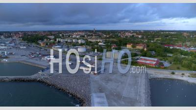 Aerial, View Over Harbor With City View In Background, Visby, Sweden - Video Drone Footage
