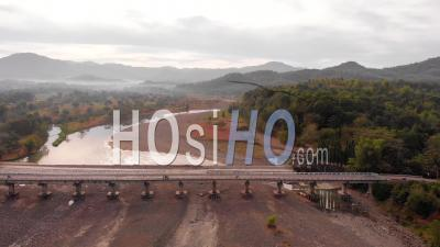 Traffic On Bridge Over River, Philippines, Drone View