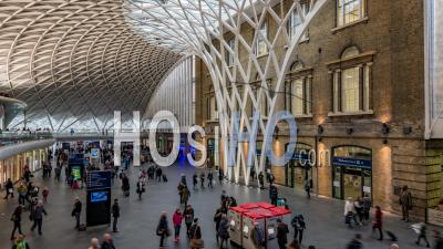 The Interior Of King's Cross Station In London With Commuters At Rush Hour