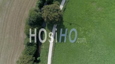 Walkers On A Path In The Countryside Near Coutances - Drone Point Of View