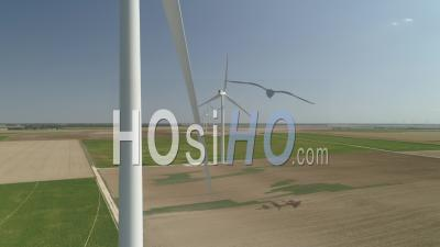 Rotating Wind Turbines And Wind Farm In Ile-De-France, Seine-Et-Marne, France, View By Drone