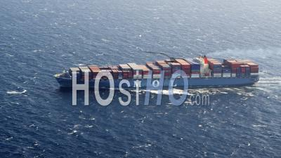 Aerial View Of Fully Loaded Container Ship Crossing Sea