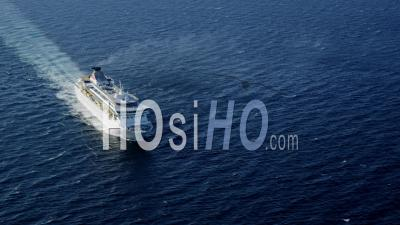 Aerial View Of Cruise Ship, Camera Moves Along Ship From Stern (back) To Bow (front)