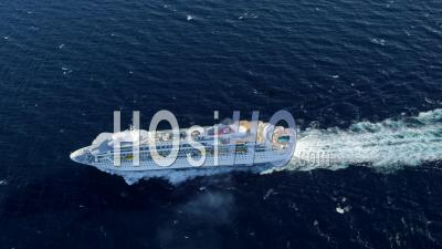 Circling Aerial View Of Cruise Ship,Camera Moves Across Bow Of Ship Right To Left