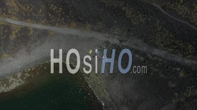 Turists Resting On Volcanic Lagoon Beach In Azores Viewed By Drone