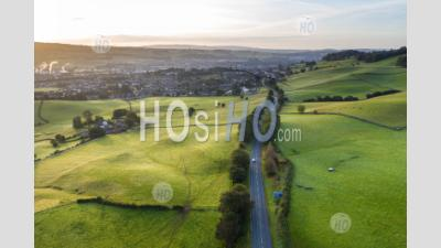 Rural Road Across Farming Fields At Sunrise - Aerial Photography