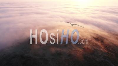 Mont Saint Michel De Braspart At Frozen Sunrise, Clouds And Sun. - Video Drone Footage