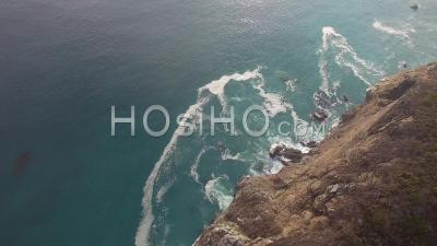 Cliff With Ocean Waves Crashing Onto Rocks - Drone Point Of View